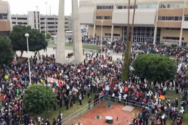 Protesters march in Mexicali.