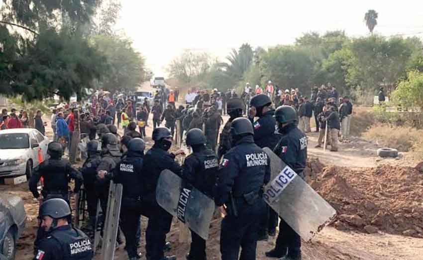 Police and protesters yesterday in Mexicali.