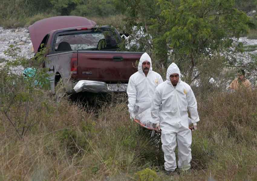 Forensic personnel and another murder victim.