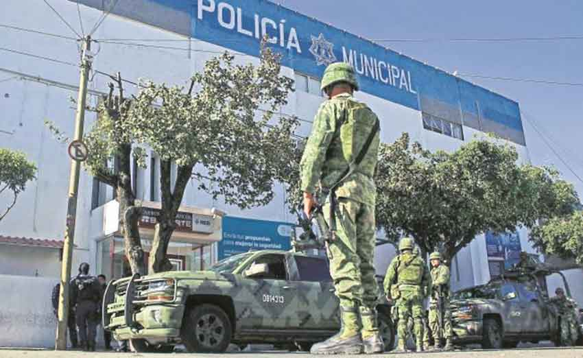Military personnel on guard at Tlaquepaque police headquarters.