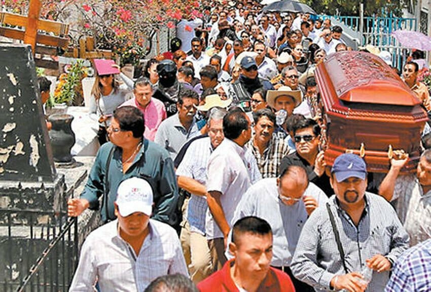 The funeral this week for a slain candidate in Guerrero.