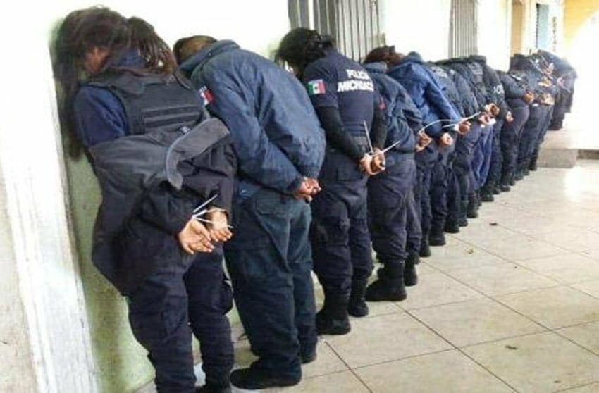 Ocampo's police force after their arrest yesterday.