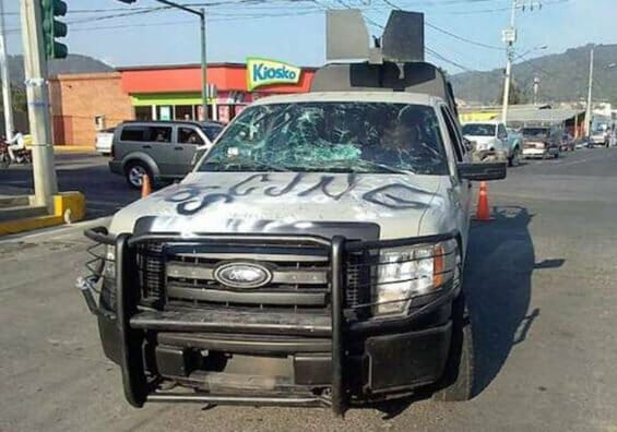Attackers painted 'CJNG' on hood of navy patrol truck.