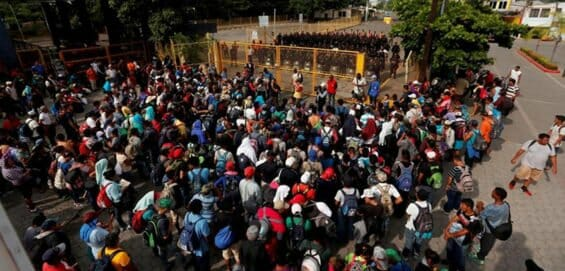 Central American migrants on the bridge at the border today.