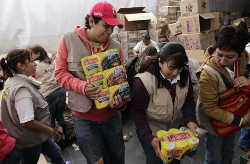 Volunteers hand out food as part of federal anti-hunger program.