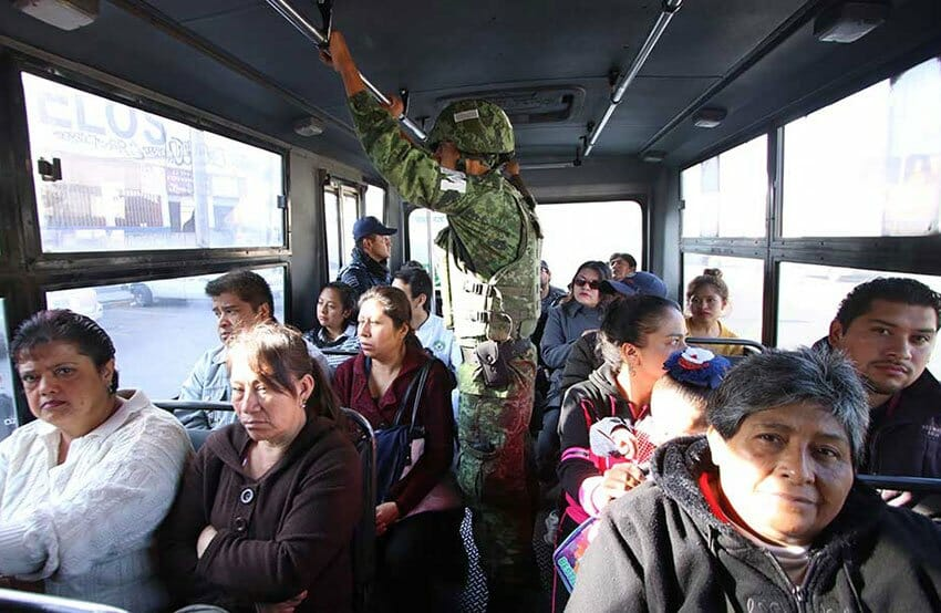 A member of the new National Guard on patrol on Puebla city public transit.