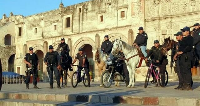 Police in Yuriria, Guanajuato, on bicycles, on horses, on foot.