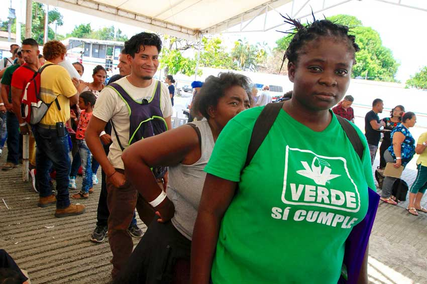Migrants line up at an immigration facility in Chiapas.