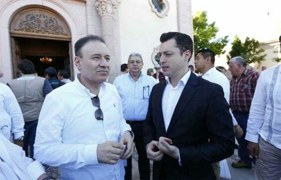 Security Secretary Durazo, left, with Colosio's son at a memorial on Saturday.