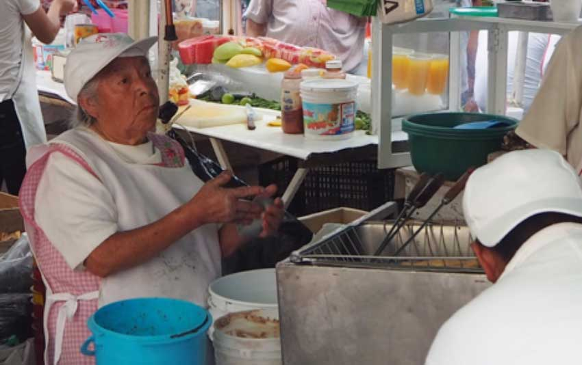 The Doña holding it all together at Barbacoa at the Condesa Friday Street Market.