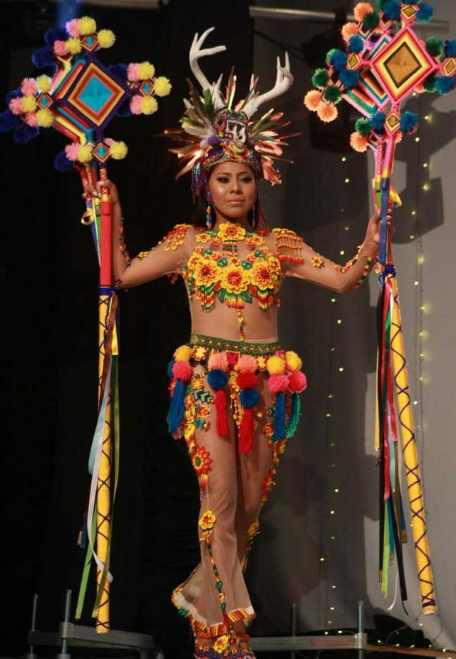 The contest winner in traditional dress.