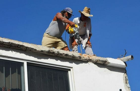 Workers on the roof. Inadvertently cutting an electrical wire cost a Miehle dishwasher.