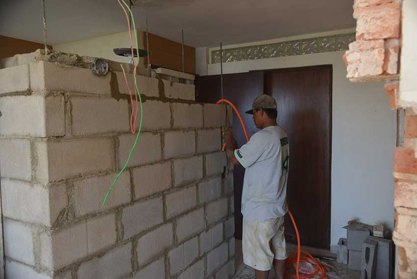 Concrete block wall such as this is not standard practice.