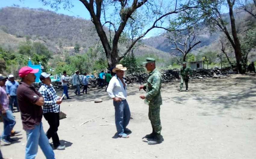 A farmer and a soldier parley in Guerrero.