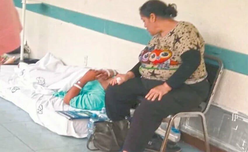 A patient waits for a bed in the hallway of a hospital in Irapuato, Guanajuato.