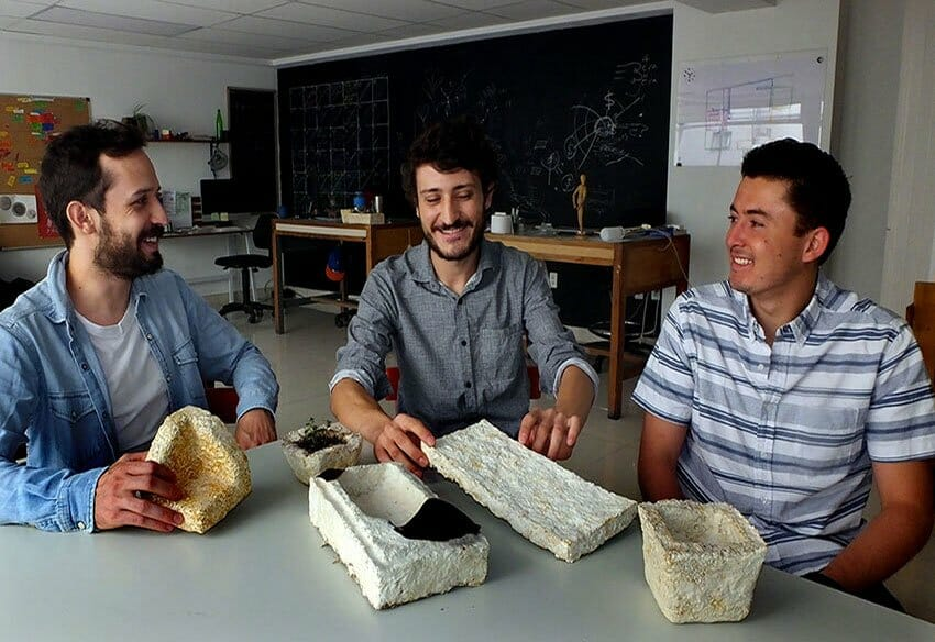 Three-fourths of the Radial team with samples of their Styrofoam substitute.