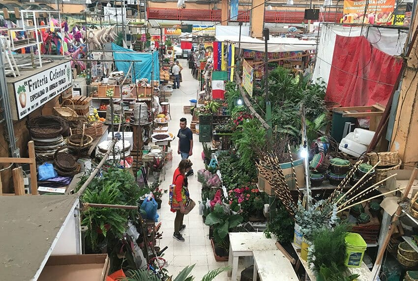Walk across the 50-plus seating area at Cha-Cha-Cha for views from above into Mercado de Medellín.
