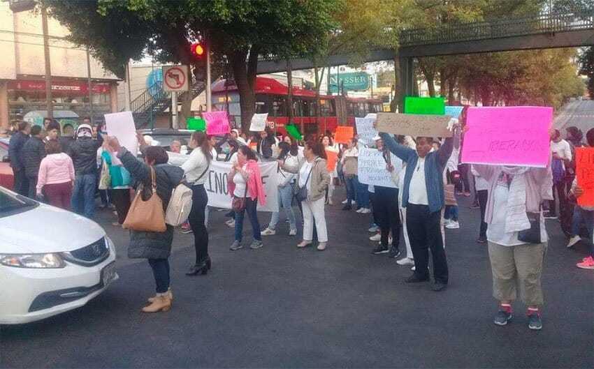 Supporters of the priest arrested in murder case protest Thursday in Mexico City.