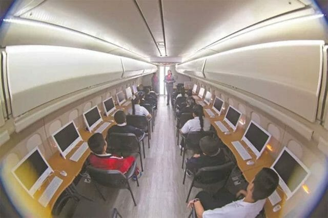 Computer terminals line either side of the fuselage.