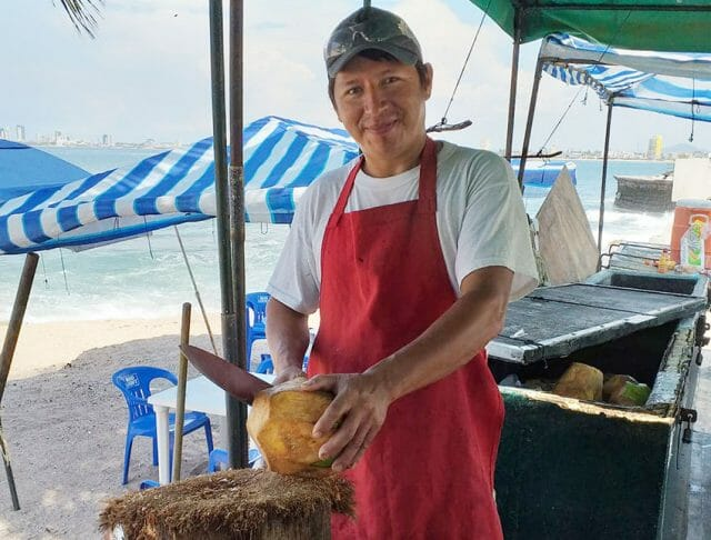cutting coconuts