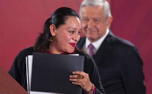 Welfare Secretary Albores presents a report at Wednesday's presidential press conference.