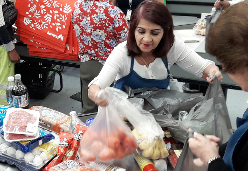 María Zarate bags groceries at a Mexico City supermarket.