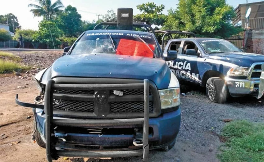 A red narco-banner on one of the vehicles in which state police officers were killed.