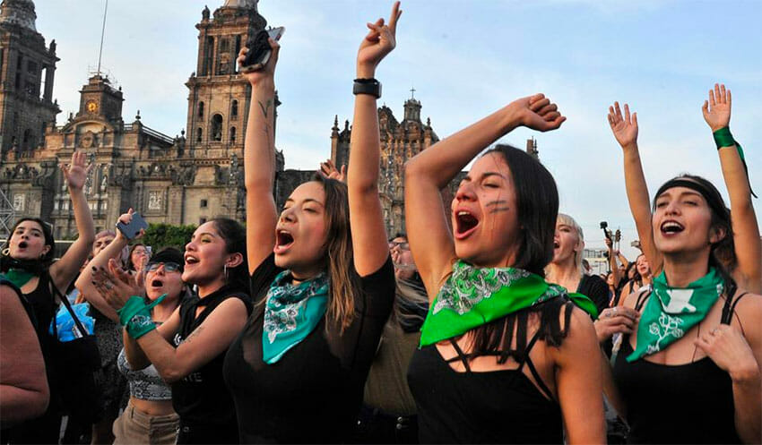 Women perform 'A rapist in your way' in the capital on Friday.