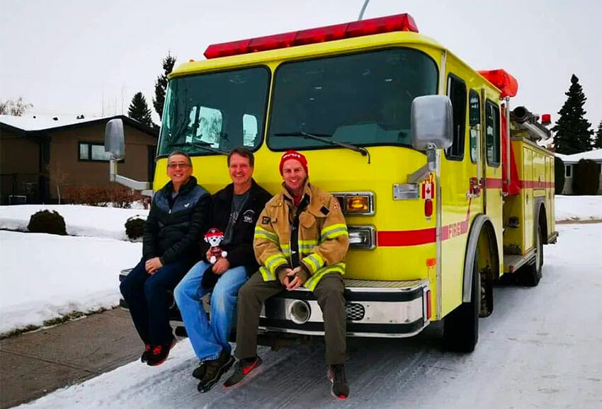 Poon, Volovich and Hardeman with Puerto Morelos' new fire truck.