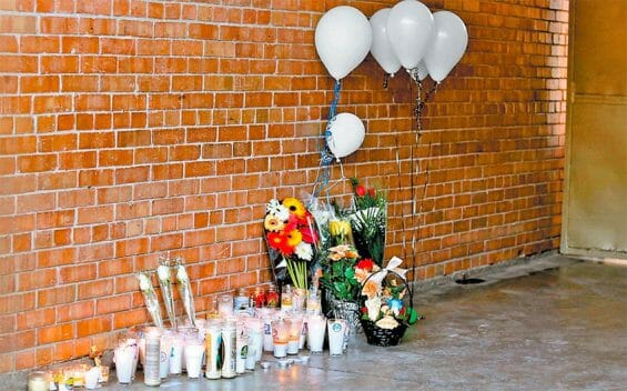 A memorial at the school where two people were killed and six wounded.