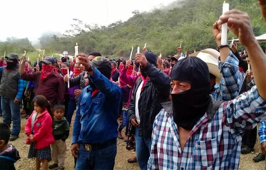 Zapatistas raise candles in protest against megaprojects.