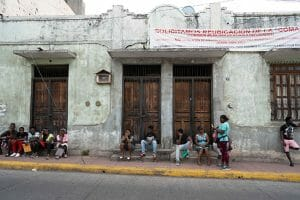 Asylum seekers wait outside the COMAR offices in the center of Tapachula.
