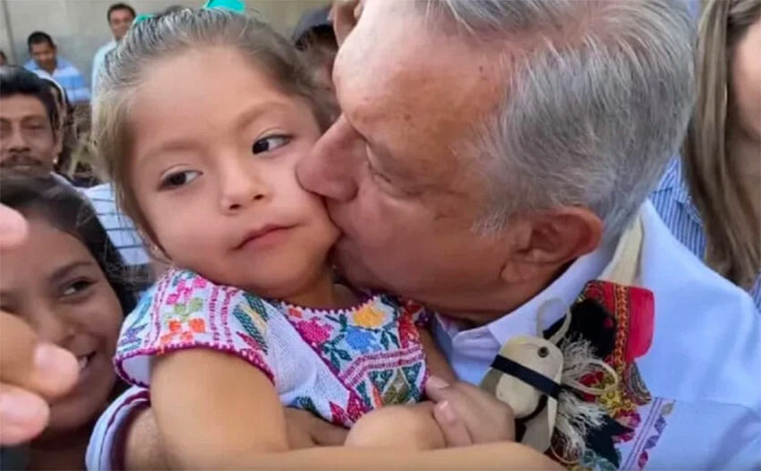 The president kisses a child in March, as the coronavirus outbreak was beginning.