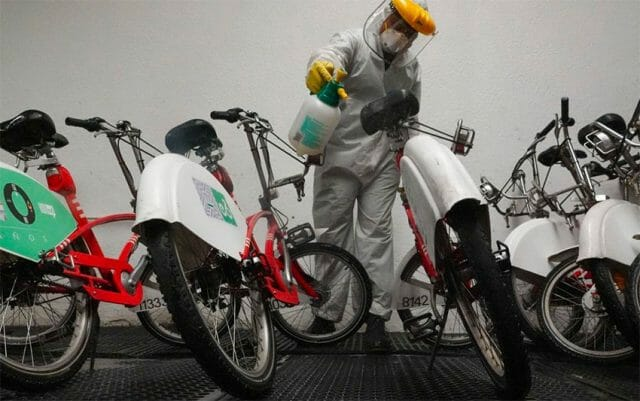 A worker disinfects bicycles belonging to Mexico City's bike sharing program Ecobici.