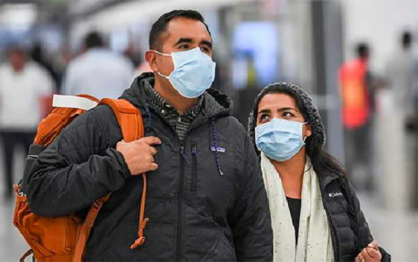 Passengers arrive at Mexico City airport. A doctor says greater efforts should be taken to test travelers.