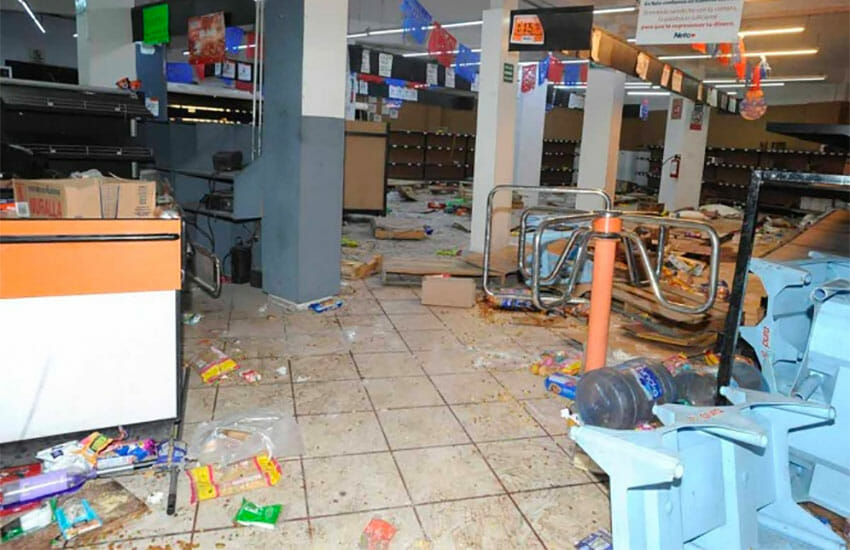 A store in México state that was damaged by looters Monday.