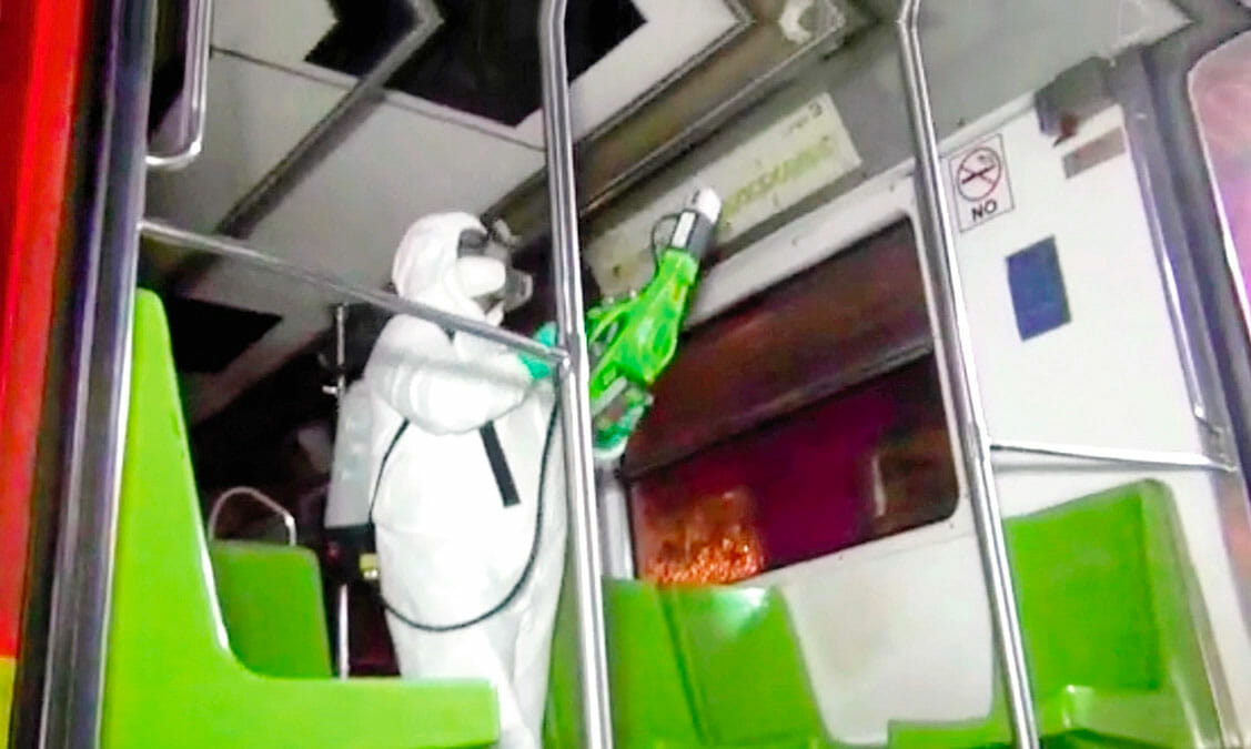 A Mexico City Metro worker disinfects a rail car.