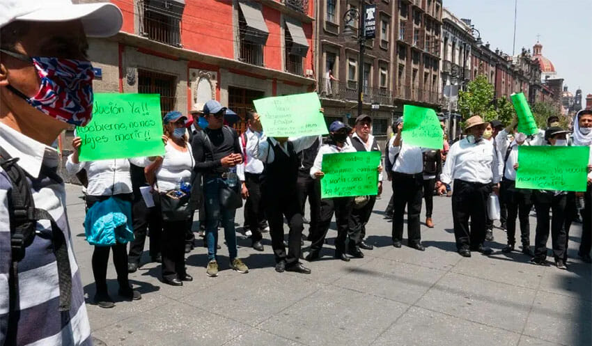 Unemployed waiters ask for economic support with a protest in Mexico City.