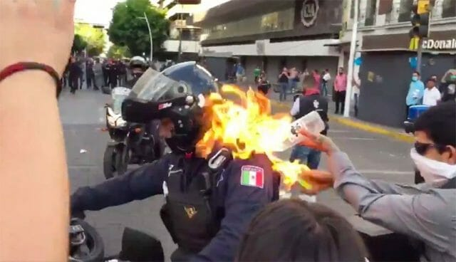 A police officer was set on fire during the protest on Thursday.