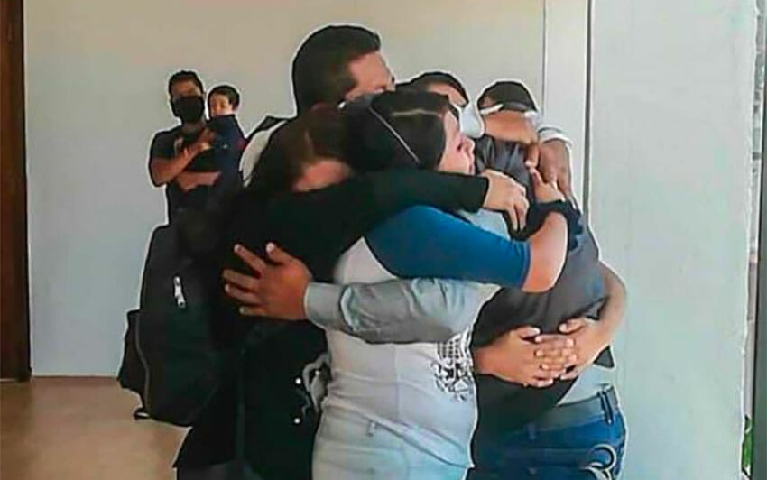 Tolentino receives a warm embrace from family members.
