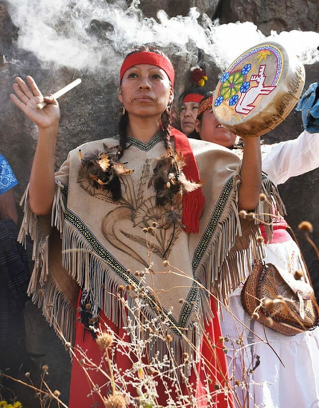 A curandera, or healer, performs a ceremony at the monoliths.