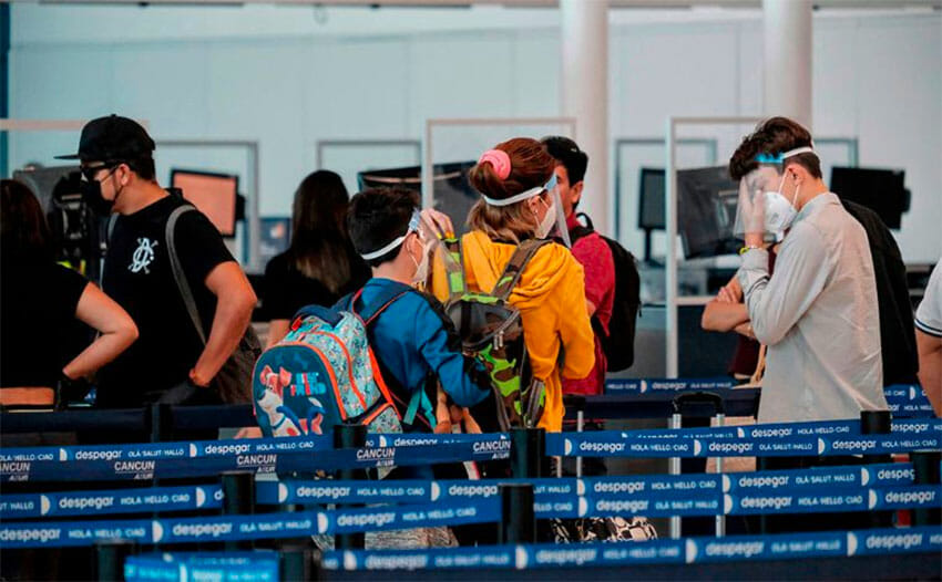 Travelers arriving in Cancún.