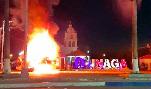 Protesters set fire to a vehicle during a protest Tuesday in Ojinaga.