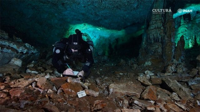 Diver Christophe Le Maillot examines evidence of mining activity.