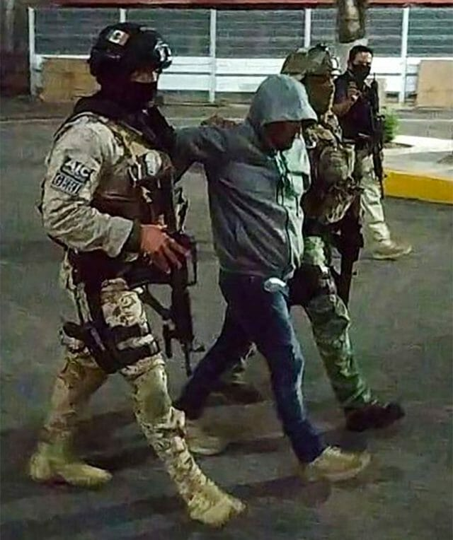 José Antonio Yépez is marched to jail by security forces.