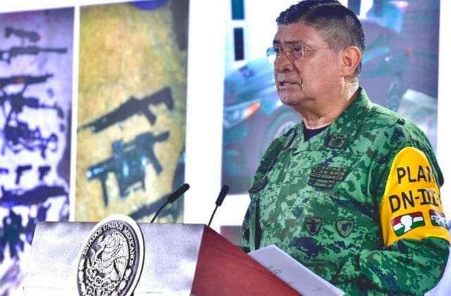Army chief Sandoval presents a report on El Marro's arrest during Tuesday's press conference.