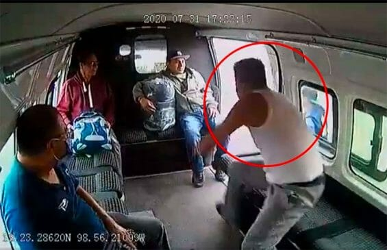 One of the two would-be thieves goes to exit the van, but didn't get very far.