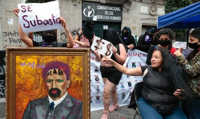 The protesters removed a painting from the building, defaced it and put it up for auction.