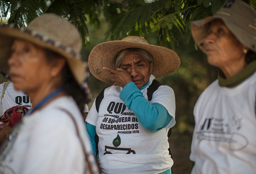 A participant wipes away tears during an international search caravan in Michoacán last year.