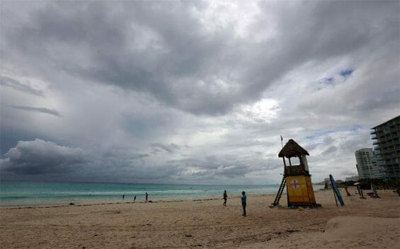 Ominous skies and a near-empty beach in Cancún prior to the arrival of Hurricane Delta.